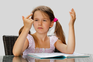 girl_counting_on_fingers_to_do_math